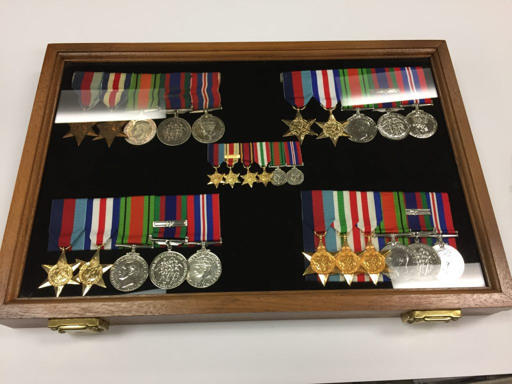 16x12x18 inch display case, showcasing miniatures surrounded by full size medals. (Upper left: original medals, swing mounted; Upper Right: swing mount copies; Lower Left: copies, special mounted; Lower Right: originals, court mounted.)